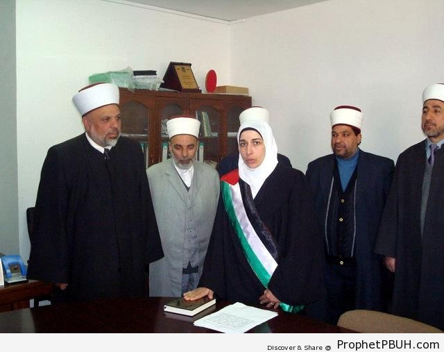 Asmahan al-Wahidi Being Sworn In as a Judge for the Shariah Court in Al-Khalil (Hebron), Palestine - Mushaf Photos (Books of Quran)