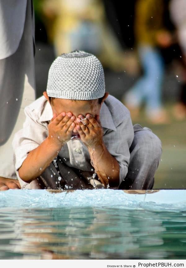 Boy Making Wudu (Ablution) - Photos