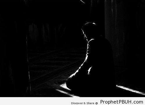 Dark Photo of Muslim Man Praying - Photos