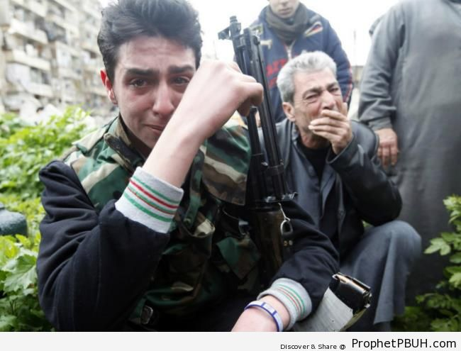 Free Syrian Army Fighters Crying Over Killed Comrade - Photos