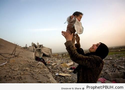 Happy Palestinian Mother and Child by Their Destroyed Home - Muslimah Photos (Girls and Women & Hijab Photos)