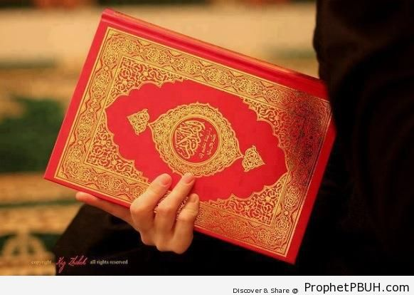 Holding a Mushaf - Mushaf Photos (Books of Quran)