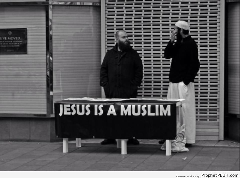 Jesus is a Muslim (Muslim Men in Britain Standing by Sign) - -Jesus is Muslim- Posters