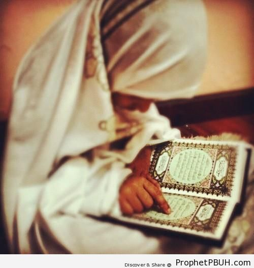 Little Girl in Hijab Reading the Quran - Mushaf Photos (Books of Quran)