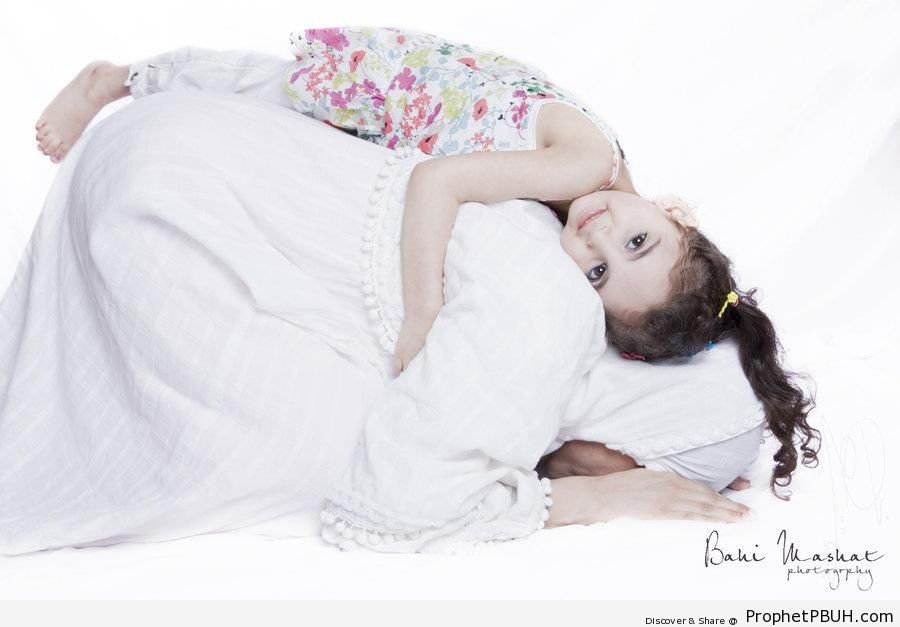Little Girl on Top of Praying Muslim Woman - Muslimah Photos (Girls and Women & Hijab Photos) -