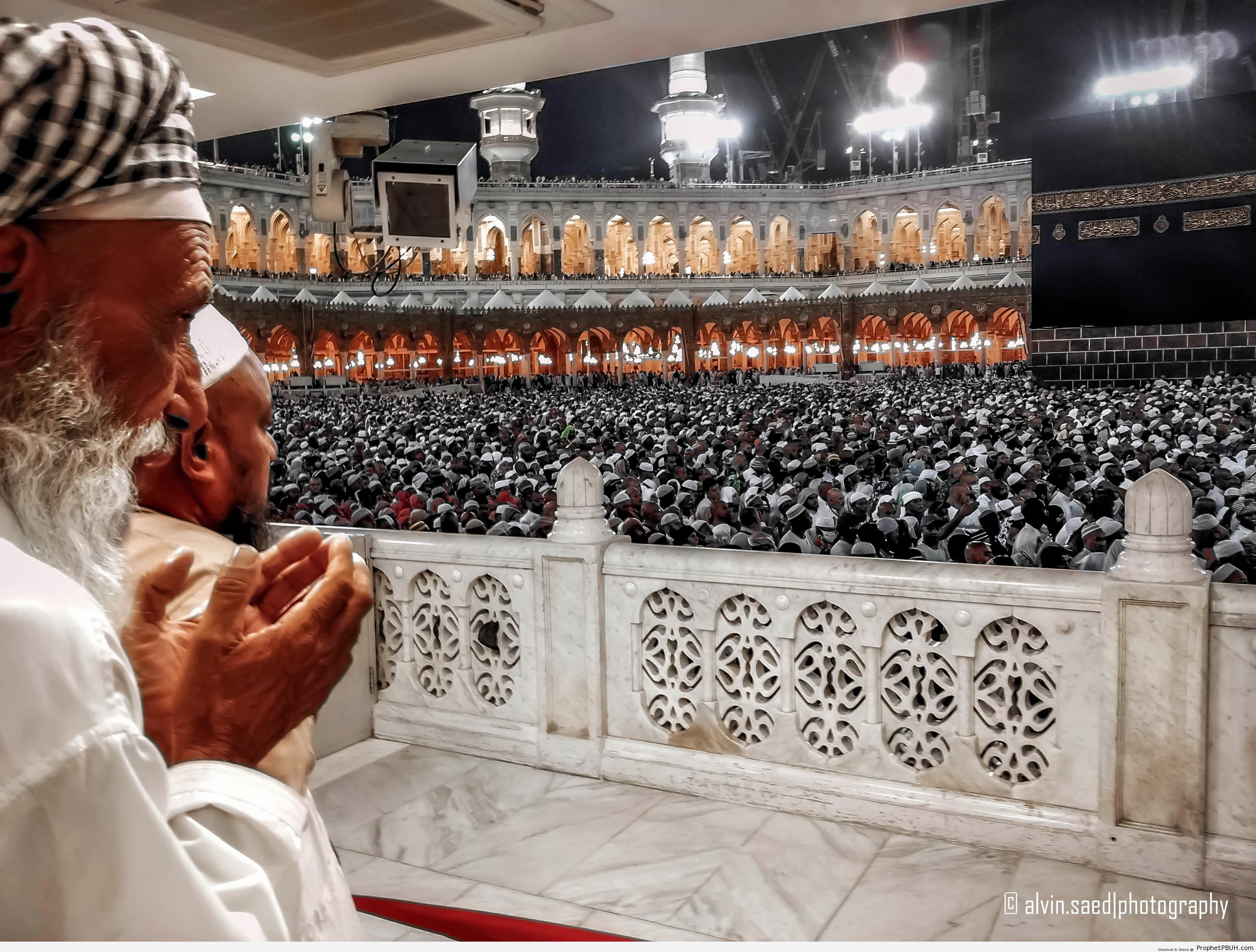 Man Making Dua at Masjid al-Haram [Nighttime Photo] - al-Masjid al-Haram in Makkah, Saudi Arabia -Pictures