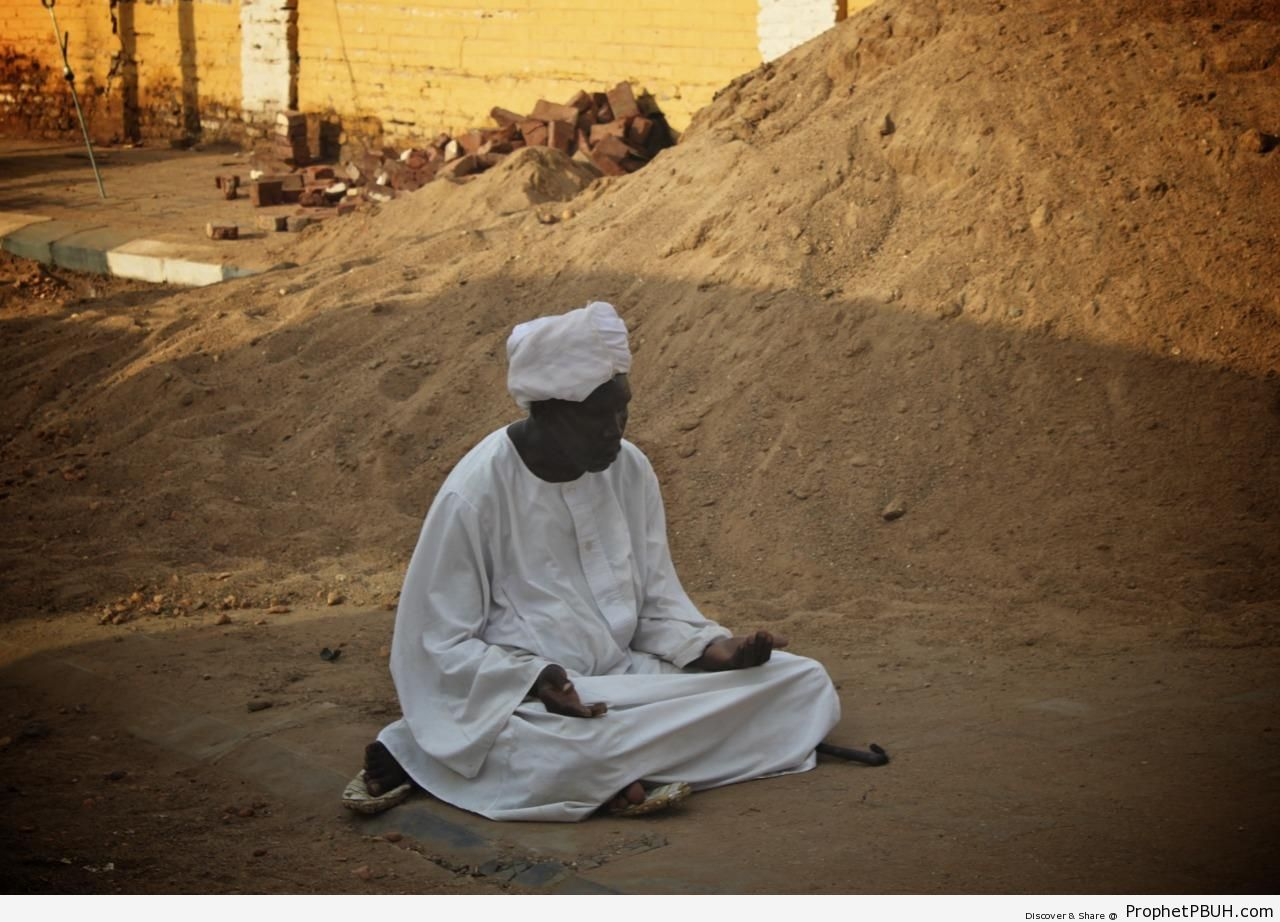 Man Making Dua in the Street (Sudan) - Photos -Pictures