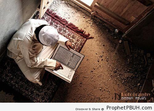 Man on Prayer Mat Reading Quran - Mushaf Photos (Books of Quran)