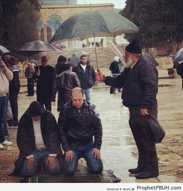 Men Praying Under Umbrella in Jerusalem Old City, Palestine - Al-Quds (Jerusalem), Palestine