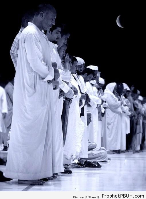 Men in Salah under Crescent Moon - Photos