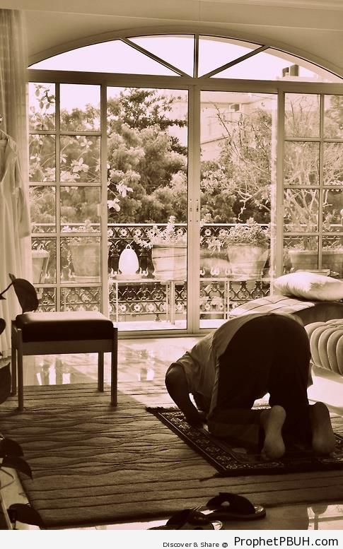 Muslim Man Praying at Home - Photos