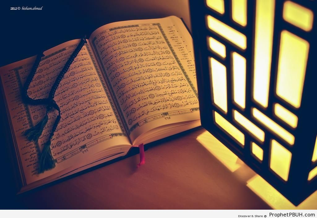 Open Book of Quran Illuminated by Lantern - Mushaf Photos (Books of Quran)
