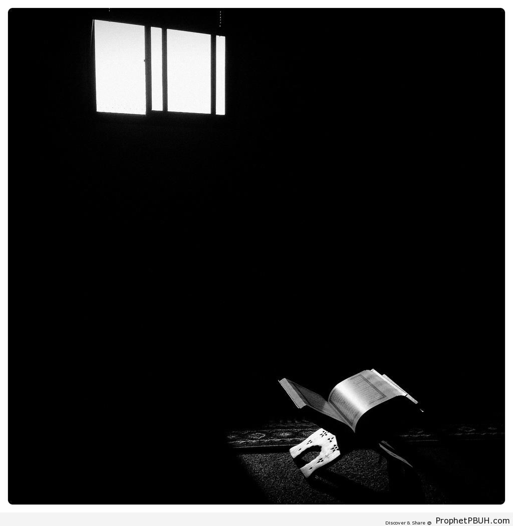 Open Book of Quran in Dark Room - Islamic Black and White Photos
