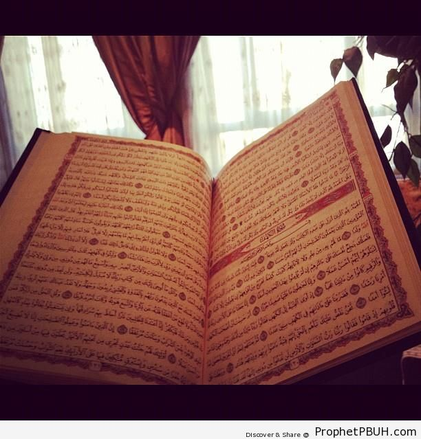 Open Book of Quran on Surat al-Kahf - Mushaf Photos (Books of Quran)