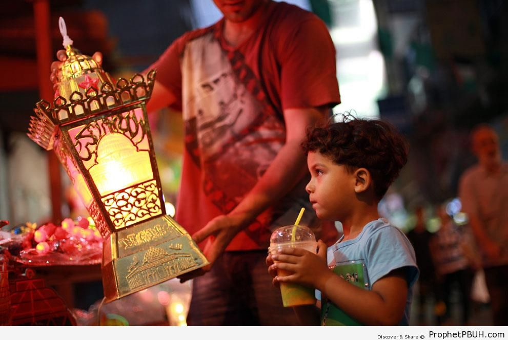 Palestinian Boy Looking at Islamic Lantern with Allahu Akbar Calligraphy (Ramadan 2013) - Allahu Akbar Calligraphy and Typography