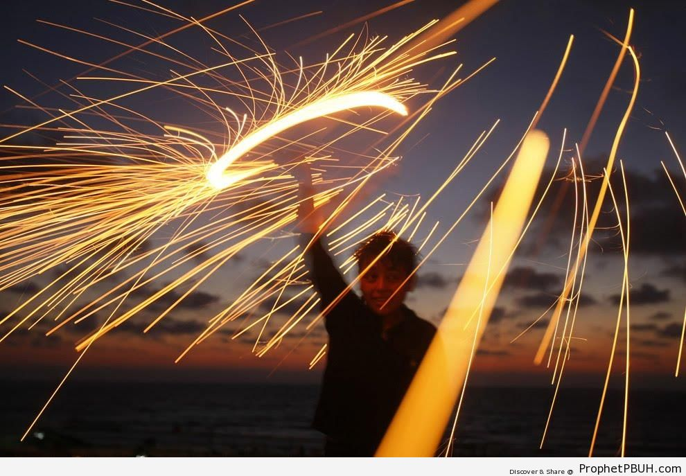 Palestinian Boy Plays with Sparkler at Maghrib Time (Ramadan 2009) - Islamic Quotes About the Month of Ramadan