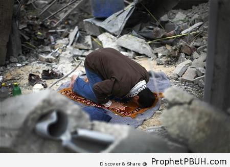 Palestinian Man Prays in Destroyed House - Photos