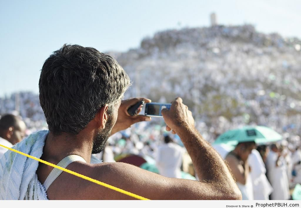 Pilgrim Taking Photo at Mount Arafat - Photos of Haj Proceedings