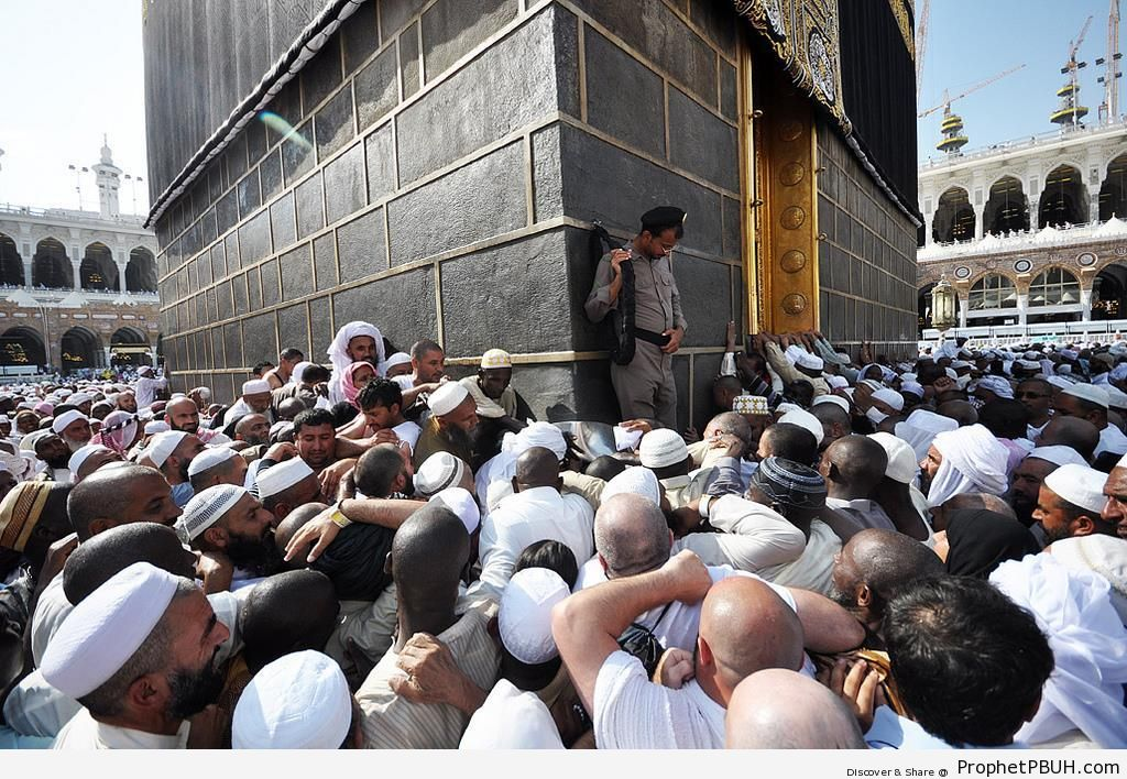 Pilgrims Trying to Kiss the Black Stone (Hajar al-Aswad) - al-Masjid al-Haram in Makkah, Saudi Arabia -Picture