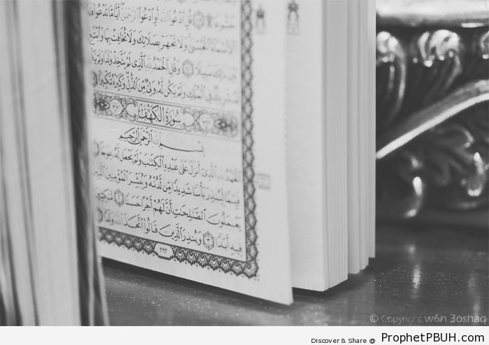 Standing Book of Quran Showing Surat al-Kahf - Islamic Black and White Photos
