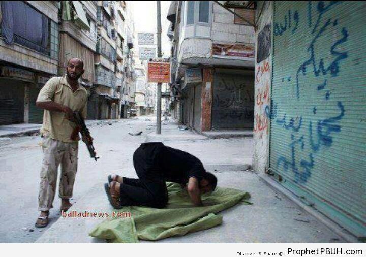 Syrian Rebel Protecting Praying Brother - Photos -