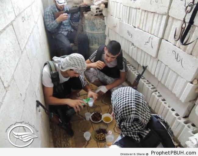 Syrian Revolutionaries Having Iftar Meal (Ramadan 2012) - Islamic Quotes About the Month of Ramadan