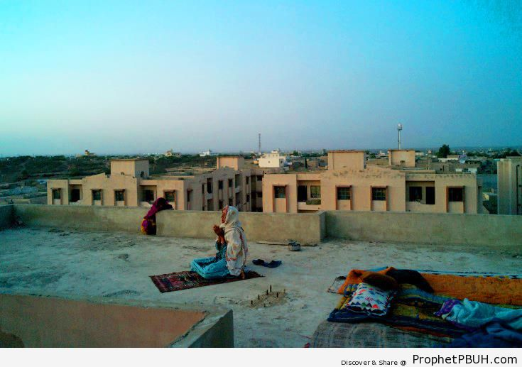 Woman Praying on Rooftop (Karachi, Pakistan) - Muslimah Photos (Girls and Women & Hijab Photos)