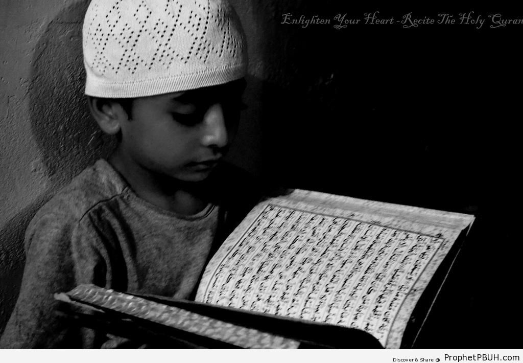 Black and White Photo of Boy Reading Quran - Islamic Black and White Photos