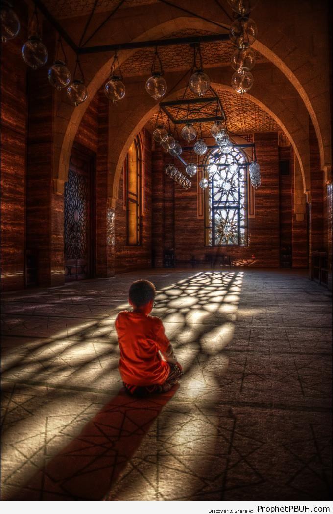 Boy Prays at Al-Fateh Grand Mosque in Manama, Bahrain - Al-Fateh Grand Mosque in Manama, Bahrain -Picture