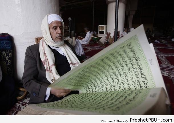 Elderly Yemeni Man Reading the Quran - Al-Jami` al-Kabir (The Grand Mosque) in Sanaa, Yemen