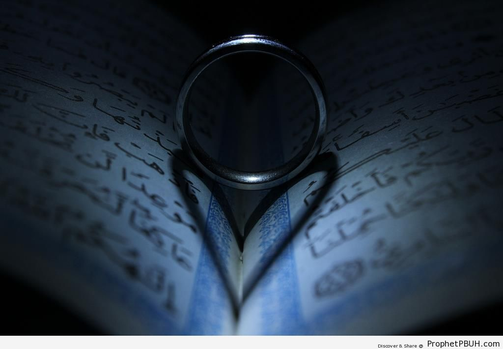 Heart-Shaped Shadow on Book of Quran - Mushaf Photos (Books of Quran)