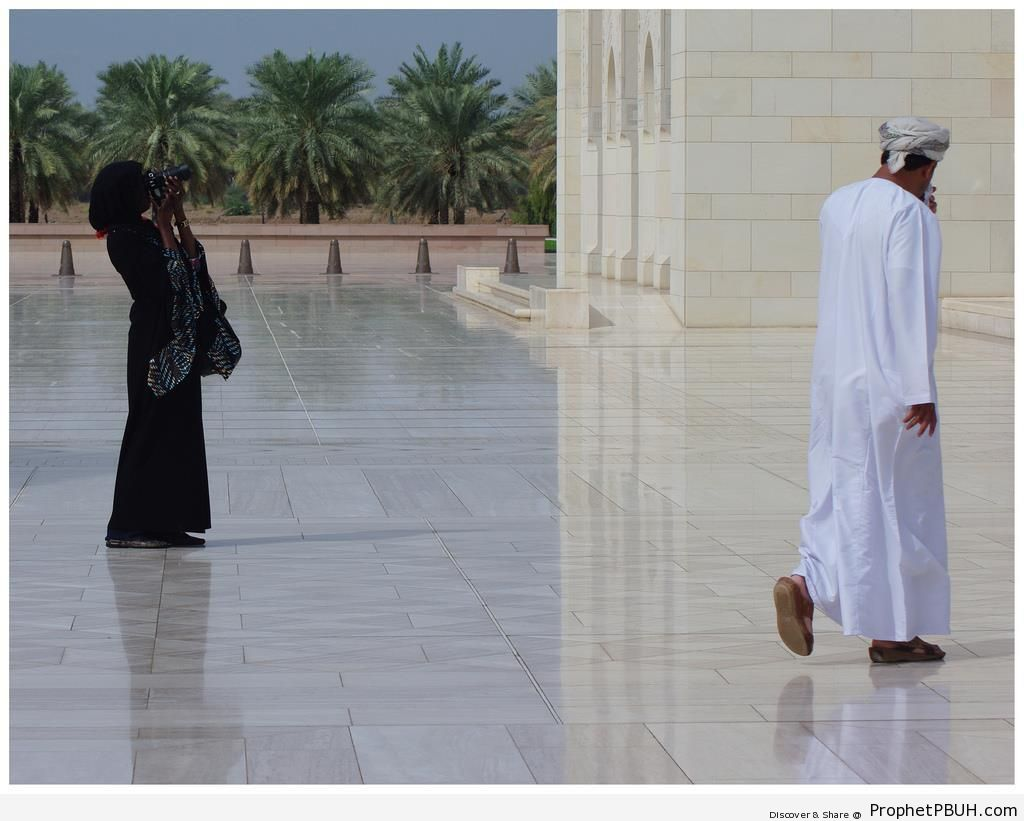 Hijabi Woman Taking Photos at Sultan Qaboos Grand Mosque in Muscat, Oman - Islamic Architecture -Picture