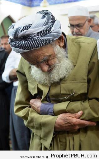 Kurdish Men in in Prayer - Photos