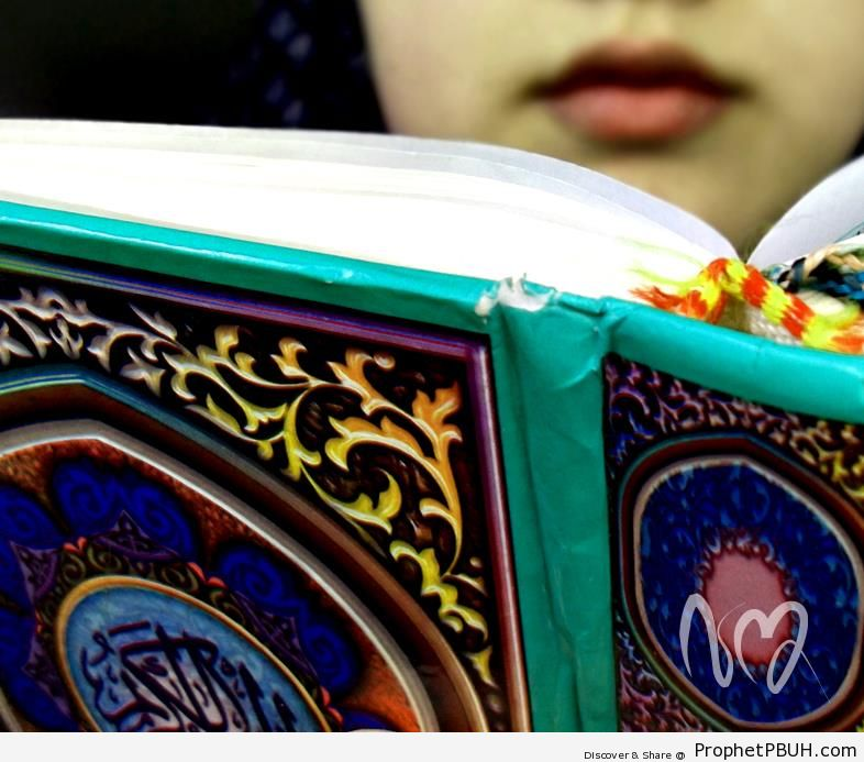 Lips Visible Over Open Quran (Photo of Girl Reading Quran) - Mushaf Photos (Books of Quran)