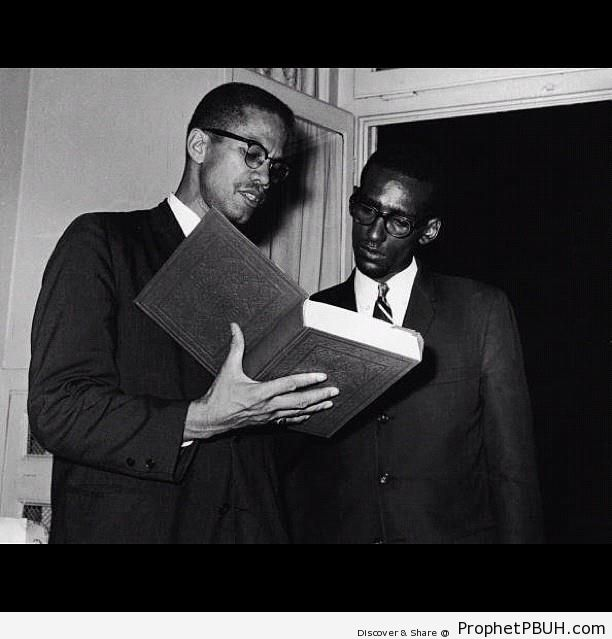 Malcolm X Holding Book of Quran - Mushaf Photos (Books of Quran)