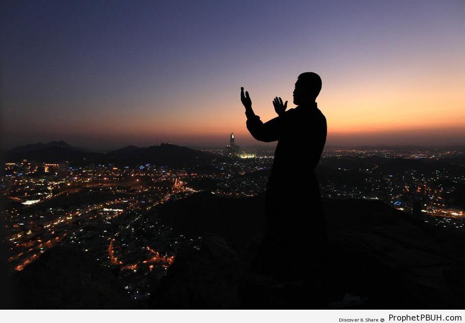 Man Prays at the Top of Noor Mountain in Makkah, Saudi Arabia - Makkah (Mecca), Saudi Arabia -