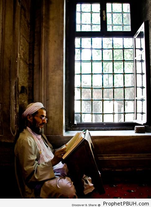 Man Reading the Quran by Window - Photos of Male Muslims