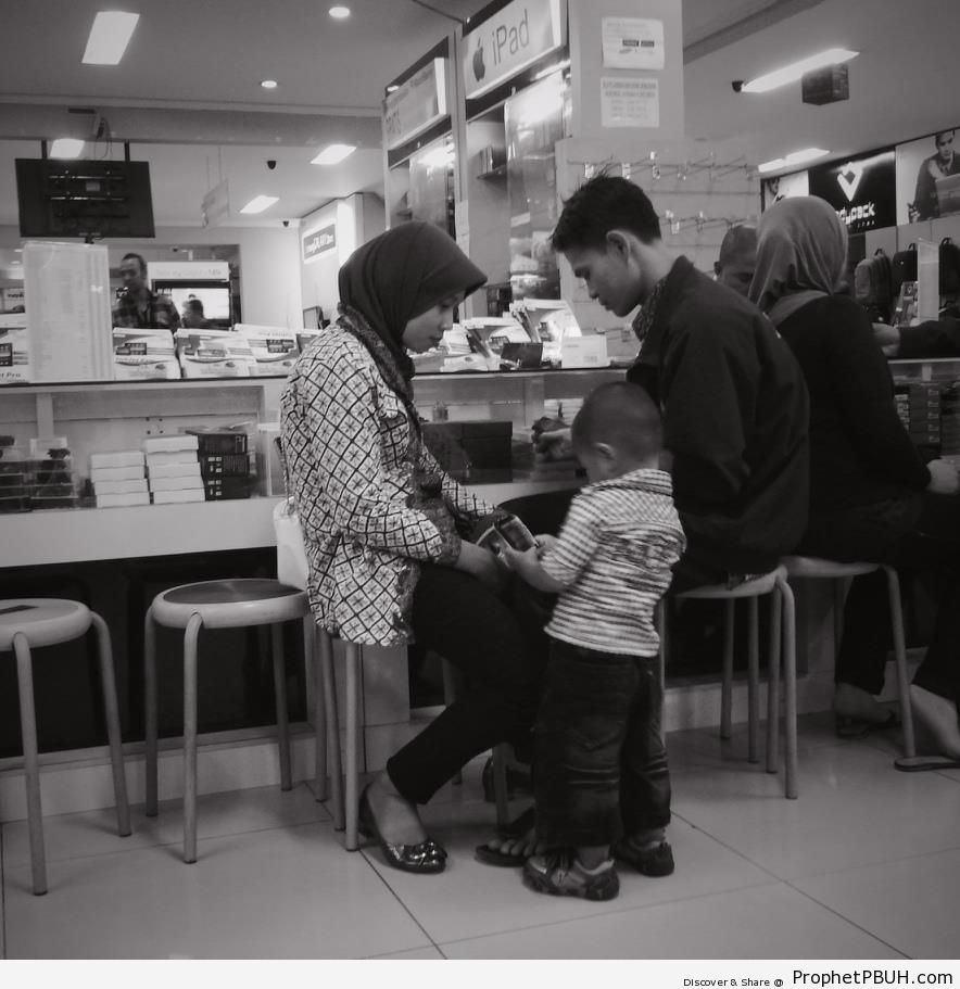 Muslim Family Browsing Electronic Gadgets - Islamic Black and White Photos -