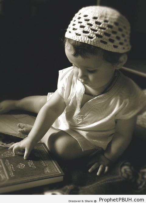Muslim Little Boy Touches a Book of Quran - Mushaf Photos (Books of Quran)