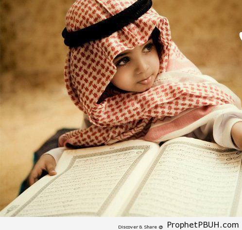 Muslim Little Boy and His Mushaf - Mushaf Photos (Books of Quran)