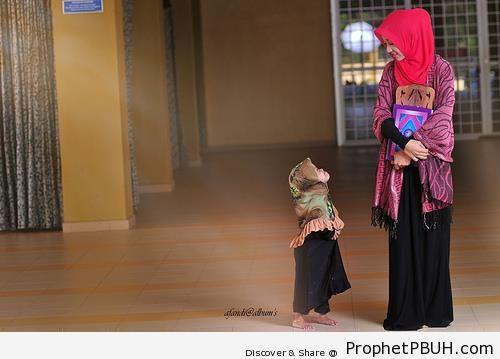 Muslim Woman Teaches Her Little Sister Quran - Mushaf Photos (Books of Quran)