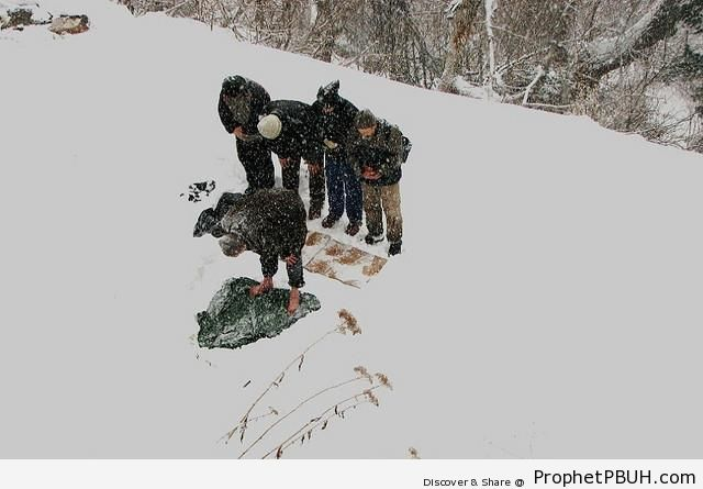Photo of Men Praying in the Snow in Turkey - Photos of Male Muslims