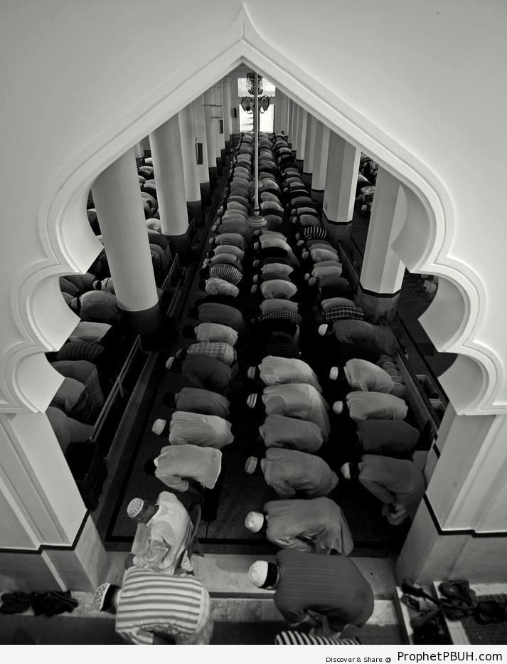 View of Praying Men Through Mosque Arch - Islamic Architecture -Picture